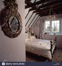 Attic Bedroom Ornate Antique Mirror And Brass Bed In Country Attic Bedroom With