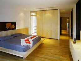 apartment contemporary bedroom interior with parquet flooring