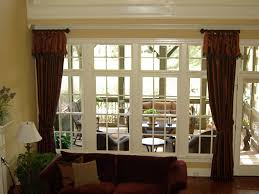 dark brown fabric curtains connected by glass windows with white