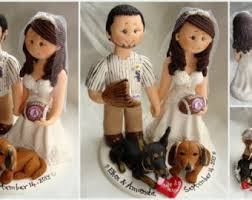 groom piggybacking bride rugby theme wedding cake topper