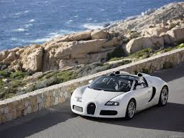 bugatti veyron grand sport cruising down a scenic coastal road