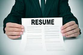 write the perfect resume how resume com can help you write the perfect resume career center a man wearing a suit showing his resume