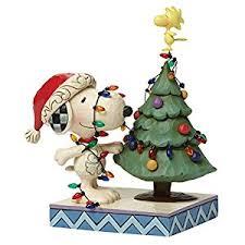 snoopy tree peanuts by jim shore snoopy with christmas tree figurine