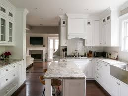 white kitchen cabinet with silver handle and santa cecilia granite