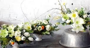spring wedding centerpiece with ivory ranunculus