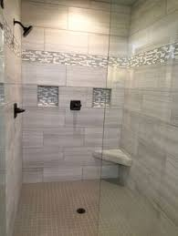 gray walk in shower boasts ceiling and walls clad in gray tiles