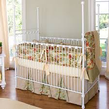 four poster iron crib in white and nursery necessities in interior