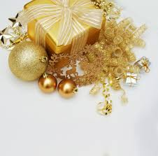 gold gift and decorations on white background photo