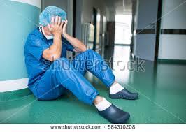 floor in sad surgeon sitting on floor corridor stock photo 584310208