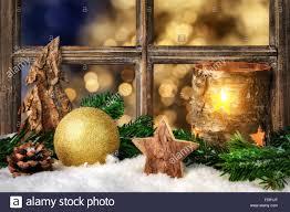 christmas advent or winter seasonal arrangement on a window sill