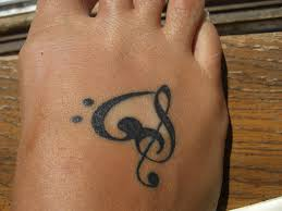 26 upbeat music note tattoo designs