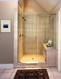 brown wall ceramic tile in shower cabin with glass door with