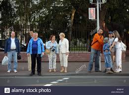 waiting for the light people waiting for the green light at traffic lights brest belarus