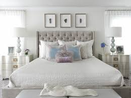 gray velvet tufted bed with silver nightstands contemporary