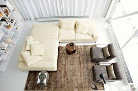 living room white chandelier gray sofa gray rug double height