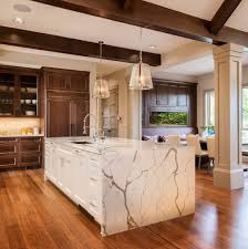 double height living kitchen transitional with wood beams stone