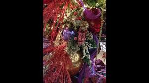 christmas tree decorations upside down red purple and gold tree