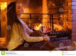 warming up at fireplace stock photo image 49480201