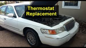 how to replace the thermostat in a mercury grand marquis