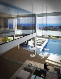 hotel avec chambre piscine priv馥 客廳窗戶旁規劃臥榻的休憩區 坐在這裡欣賞都市景觀 當陽光灑入時便是最