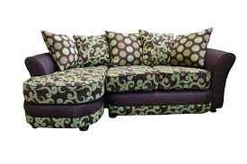 purple floral pattern vinyl couch with panel armrest and polkadot