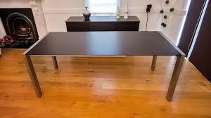 magnificent wenge dark wood extending dining table brushed metal