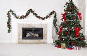 natural gas fireplace with fully decorated christmas tree in