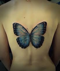 lower back decorated with big butterfly made by expert