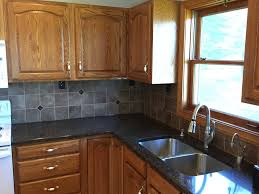kitchen backsplash accent tile gray and tan kitchen clear glass cabinet knobs corian countertops