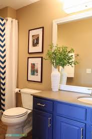 guest bathroom makeover before and after life virginia street bathroom vanity makeover using country chic paint guest lighting and framing builder grade mirror details