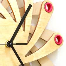 galaxy contemporary stylish wall clock made of bent plywood