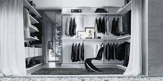 white walk in closet with cloth hooks and floating shelves on the