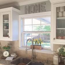 window ideas for kitchen i like the raised window and the glass cabinets around it