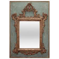 19th century hand carved italian mirror on painted wood panel for