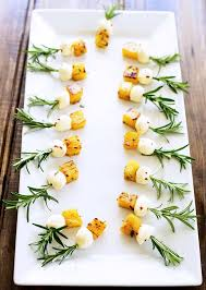 shoing canapé rosemary pineapple mozzarella bites sprinkles and sprouts