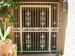 beautiful custom wrought iron gate adds to the inviting entry of