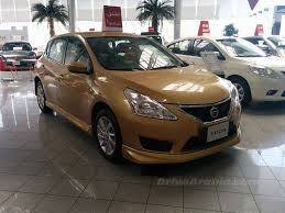 nissan showroom qatar 2014 nissan tiida offered with optional body kit in uae drive arabia