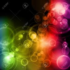blurry lights in rainbow colors on background with space