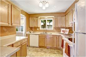 luxury kitchens with white appliances and oak cabinets