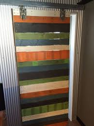 colorful wood pallet wall and sliding barn door 4 steps with