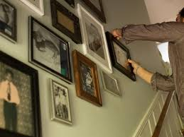 arranging create a gallery wall in a stairwell hgtv