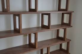 handmade walnut bookcase modern and modular by packsaddle road