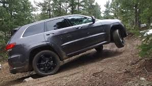 grey jeep grand cherokee 2016 2016 jeep grand cherokee overland takes on a snowy muddy gold mine