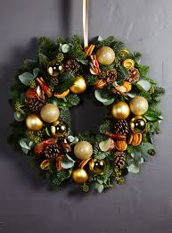 golden outdoor wreath larry walshe floral design