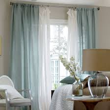 nice window treatment with the sheers behind the main drapes for