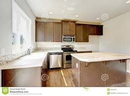 new home kitchen interior with dark brown cabinets stock image