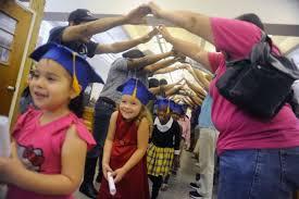 pre k cap and gown pre school graduation sad symptom of accelerated childhood
