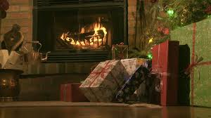 presents and fireplace in a living room christmas scene stock