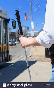 Blind Man Cane Young Blind Man With Cane Waiting At A Bus Stop Stock Photo