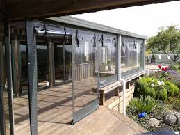 Clear Vinyl Patio Enclosure Weather Curtains by Roll Up Screens Cafe Screens Drop Screens Auckland Cairnscorp